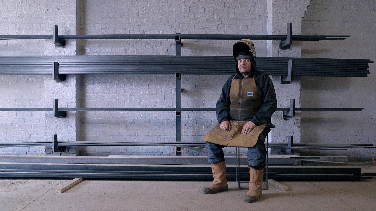 Man sitting on stool - Advertising Videos - Video services bristol